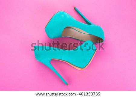 Fashion beautiful women's high-heeled shoes and blue women's panties on a bright pink background - stock photo