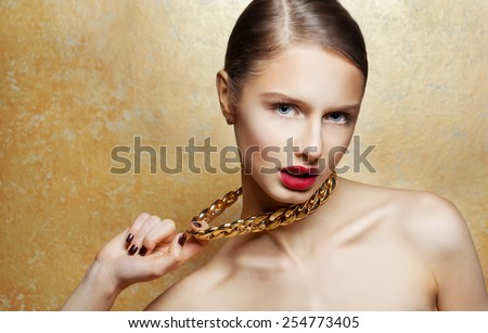 Fashion Beauty Girl Portrait Isolated on golden Background. Glamour Makeup. Gold Jewelry. Hairstyle. - stock photo
