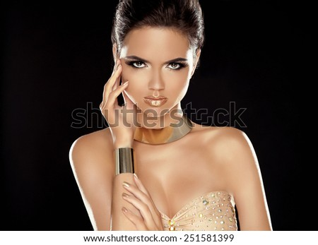 Fashion Beauty Girl with Golden Jewelry. Makeup. Stare. Vogue Style. Glamour Lady. Luxury Woman Portrait.