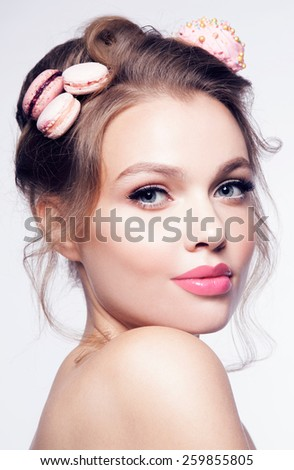 fashion beauty girl with pink and lips with macaroons on the hair - stock photo