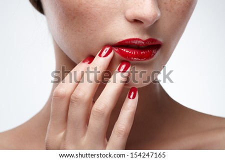 Fashion Beauty Makeup. Beautiful Woman With Red Lips and nail . - stock photo