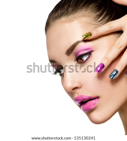 Fashion Beauty. Manicure and Make-up. Nail art. Beautiful Woman With Colorful Nails and Luxury Purple Makeup. Beautiful Girl Face and Hand - stock photo
