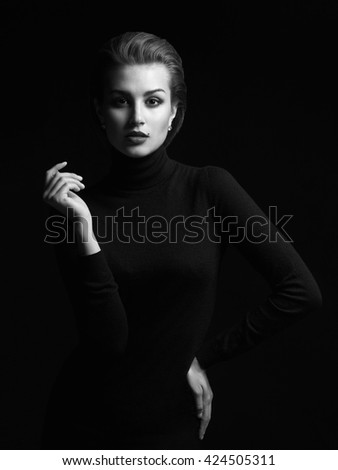 fashion beauty monochrome portrait of a young woman in a black roll neck jumper. beautiful girl with short hair - stock photo