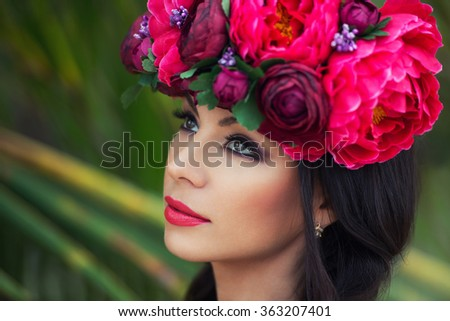 Fashion beauty portrait of beautiful brunette girl with wreath of flowers on her head - stock photo