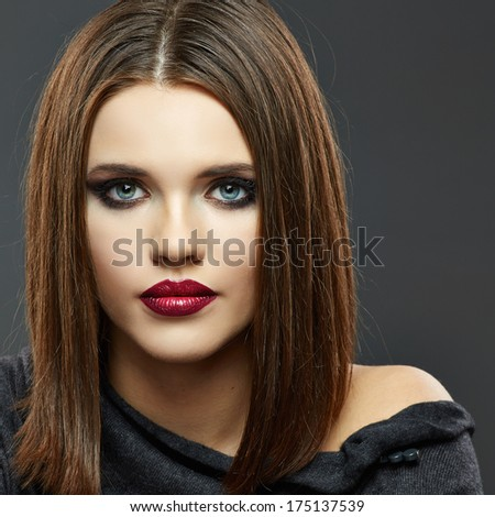Fashion Beauty Portrait of Young Woman on Gray Background Isolated.