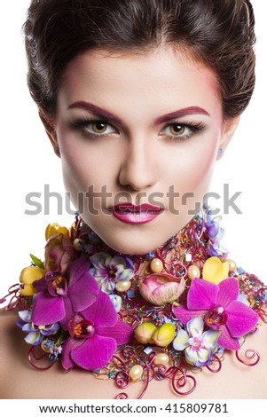 Fashion Beauty woman with flowers in her hair and around her neck. Perfect Creative Make up and Hair Style. Hairstyle. Bouquet of Beautiful Flowers. It can be used for advertising perfume