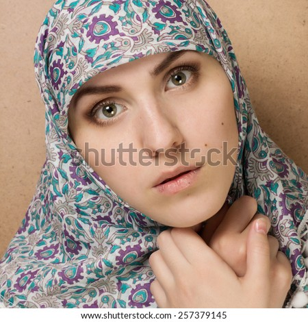 Fashion black and white portrait of young beautiful Muslim woman