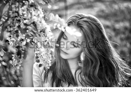 Fashion black and white portrait of young sensual woman in garden. - stock photo