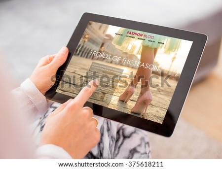 Fashion blog / website on digital tablet - stock photo