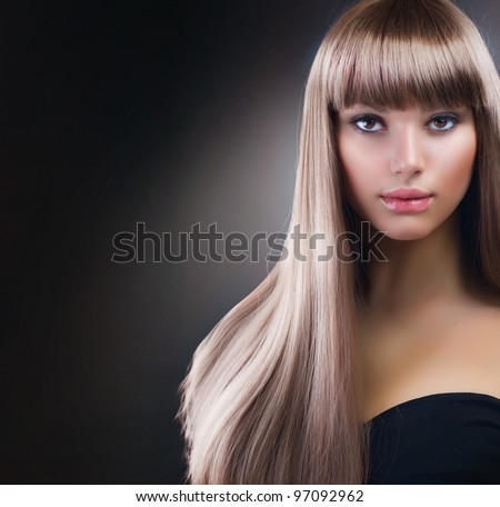 Fashion Blond Girl. Beautiful Makeup and Healthy Hair over Black Background - stock photo