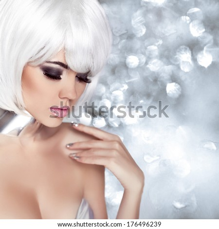 Fashion Blond Girl. Beauty Portrait Woman. Makeup. White Short Hair. Isolated on blinking Christmas Background. Face Close-up. Manicured nails. Vogue Style. - stock photo