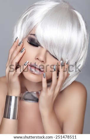 Fashion Blond Girl. Beauty Portrait Woman. White Short Hair. Isolated on Grey Background. Face Close-up. Manicured nails. Hairstyle. Fringe. Vogue Style. - stock photo