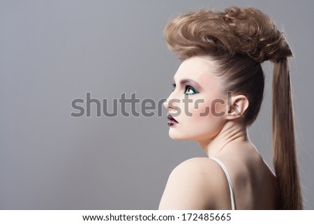 Fashion Blond Model Portrait. Hairstyle. Haircut. Professional Makeup. Unusual creative makeup. Closeup portrait. Studio shot. - stock photo