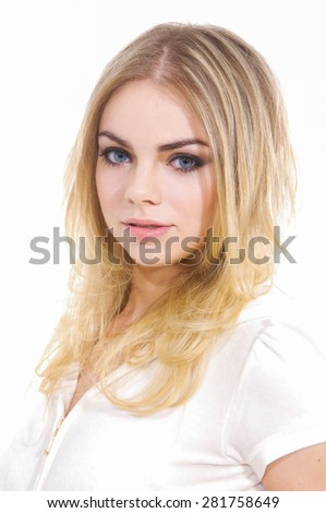 Fashion blond model posing in studio 