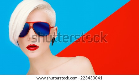 Fashion Blond Model with trendy Haircut and Sunglasses on bright background - stock photo