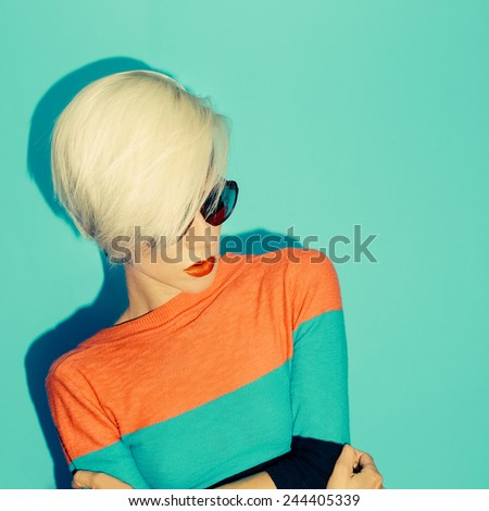 Fashion blond Model with trendy Hairstyle on blue background.  - stock photo