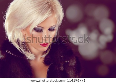 Fashion blond woman lady with coiffure hairstyle - stock photo