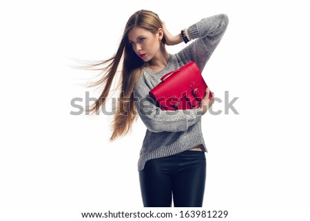 fashion blonde girl holding red handbag - stock photo