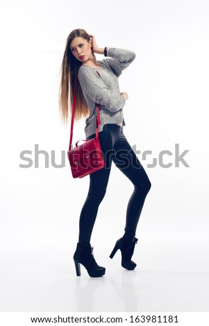 fashion blonde girl holding red handbag wearing high heels - stock photo
