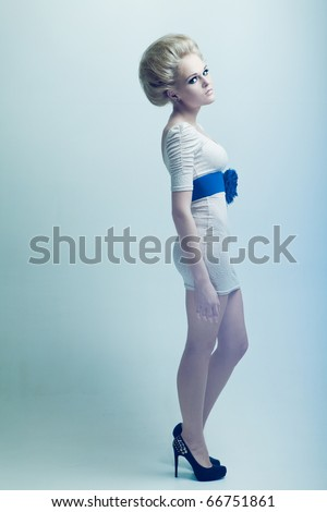 Fashion blonde in a dress - stock photo