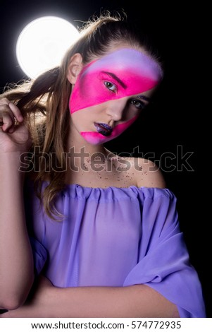 Fashion Blonde Model Portrait.  Professional Makeup. Eyelashes. Purple and lilac Make-up. Two fases. Fantastic make up.