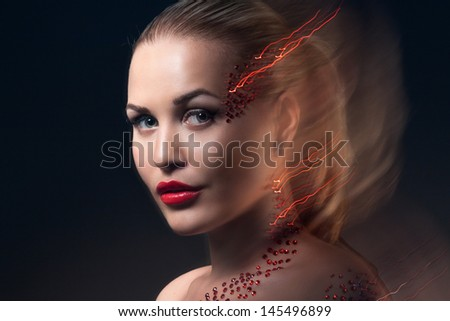 Fashion Blonde Model Portrait. Professional Red Makeup over black background