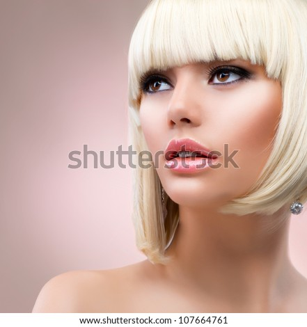 Fashion Blonde Woman Portrait. Blond Hair. Hairstyle. Haircut. Makeup - stock photo