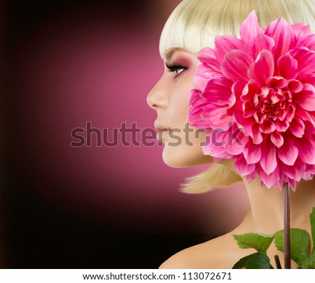 Fashion Blonde Woman with Dahlia Flower. Blond Hair. Hairstyle. Haircut. Makeup - stock photo