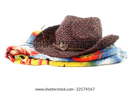 fashion brown straw  hat and beach towel on a white background