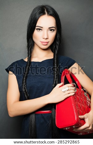 Fashion Brunette. Beautiful Makeup and Long Healthy Black Hair - stock photo
