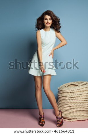 Fashion brunette girl wearing pastel clothes
