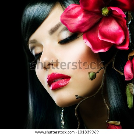 Fashion Brunette Girl with Magnolia Flower isolated on Black - stock photo