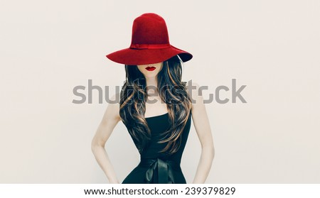 Fashion Brunette Lady in red hat and red lips on white background - stock photo