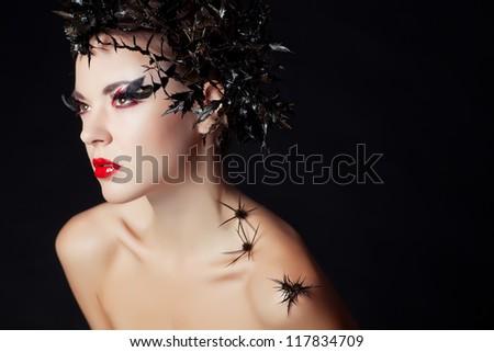 Fashion Brunette Model Portrait. Hairstyle. Haircut. Professional Makeup. False Eyelashes - stock photo