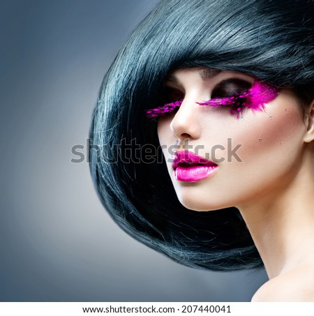 Fashion Brunette Model Portrait. Hairstyle. Haircut. Professional Makeup. False pink feather Eyelashes. Purple Lipstick. Make-up. Hairstyle. Haircut. Hairdressing. Fashion Art. Vogue Style  - stock photo