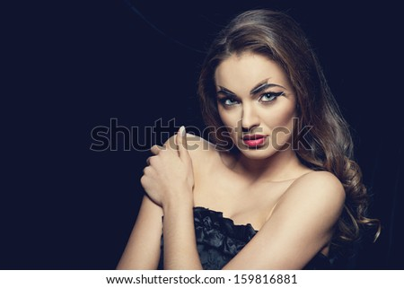 Fashion brunette model portrait with creative make-up red lips