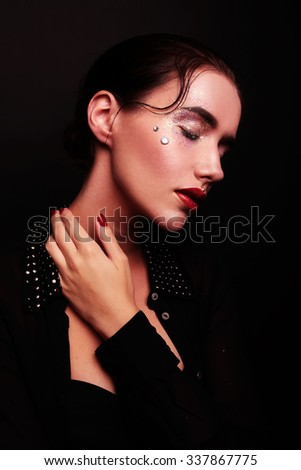 Fashion Brunette Model Portrait with red lips and red nails.  - stock photo