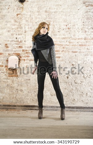 fashion brunette women wear leather jacket, pant and shoes in the old building