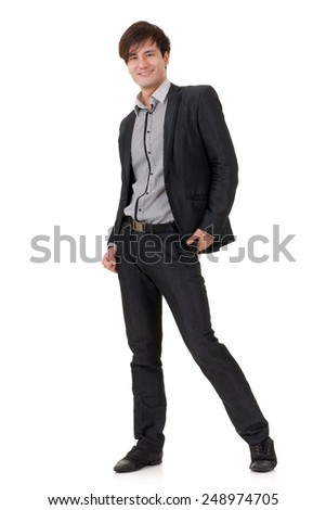 Fashion business man posing with confident expression on face, studio shot on white background with reflection.