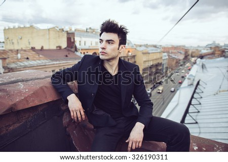 Fashion businessman on the roof