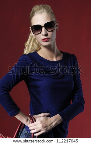 fashion casual girl with sunglasses on red background