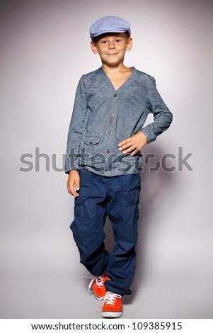 Fashion child. Happy boy model - stock photo