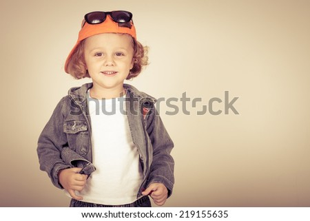 Fashion child. Happy boy model. Stylish little boy in baseball.  Handsome  kid  in the jeans jacket. - stock photo