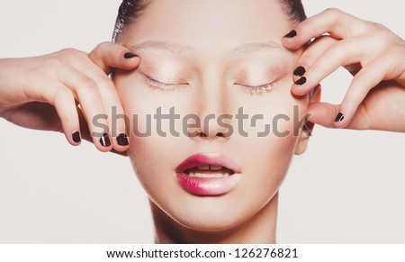 Fashion close-up portrait of attractive young model. Dark nails & gradient lips makeup. - stock photo