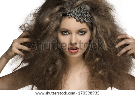 fashion close-up portrait of very sexy young girl with curly hairdo, glitter accessory in the hair and sexy make-up  - stock photo