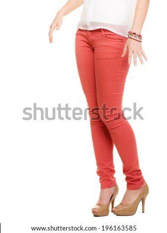 Fashion. Closeup of sexy female legs in red pants and beige high heels shoes boots isolated on white. - stock photo