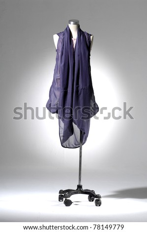 Fashion clothes on a mannequin in light background
