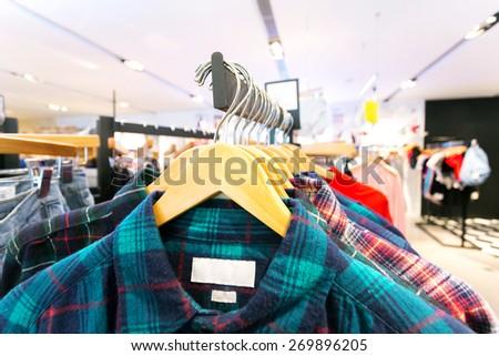 fashion clothes shop interior  - stock photo