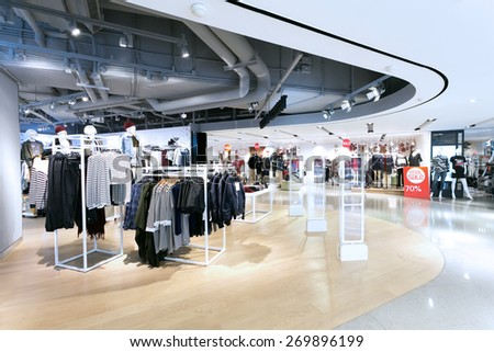 fashion clothes shopfront in shopping mall - stock photo
