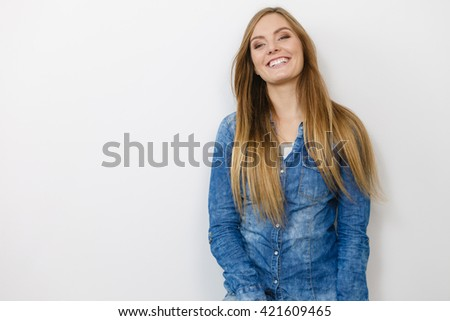 Fashion, clothing, people concept. Attractive young woman with jeans jacket. Girl is posing in the studio. - stock photo